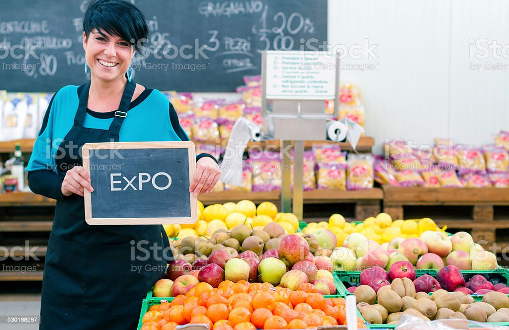 Young woman holding blackboard with Expo sign stock photo