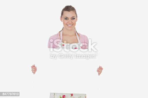 istock Young woman holding blank billboard 847797610