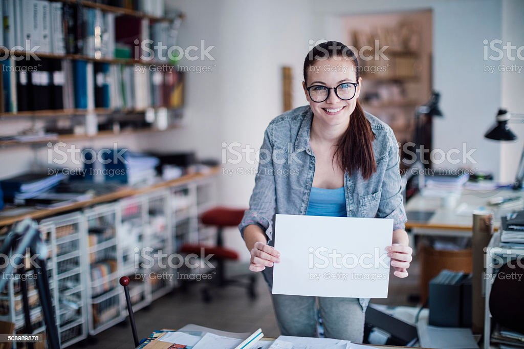 Young woman  holding blank board stock photo