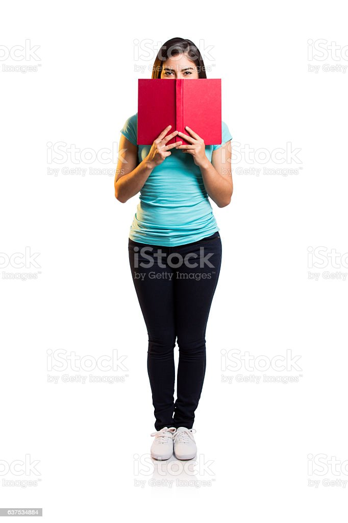 Young woman holding book over mouth - foto de stock