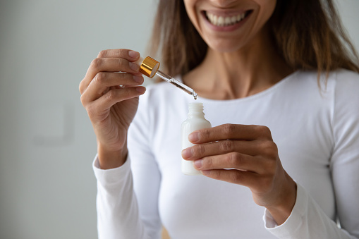 istock Young woman holding bottle with collagen moisturizer face serum 1192627535