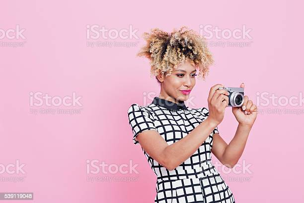 Young Woman Holding Camera Stock Photo - Download Image Now