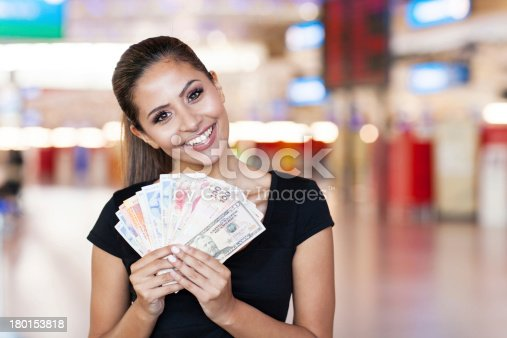 istock young woman holding cash outside casino 180153818