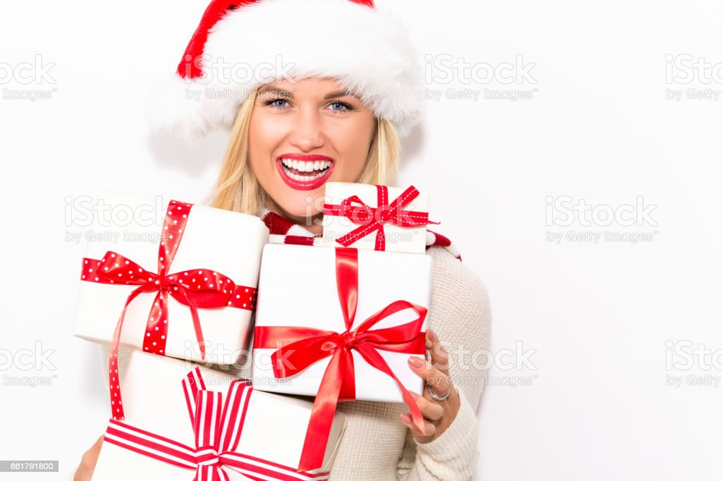 Young Woman Holding Christmas Gifts Stock Photo & More Pictures of ...