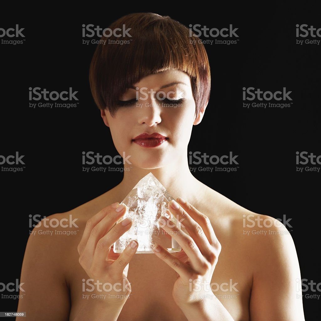Young Woman Holding Crystal. Isolated. royalty-free stock photo