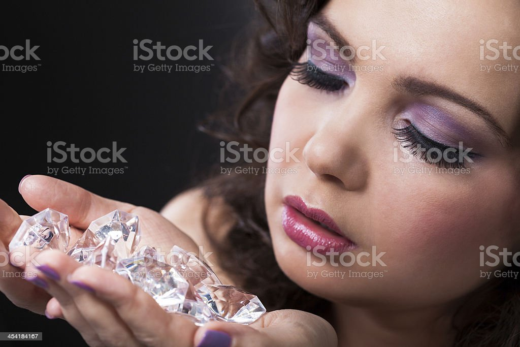 Young Woman Holding Diamonds royalty-free stock photo