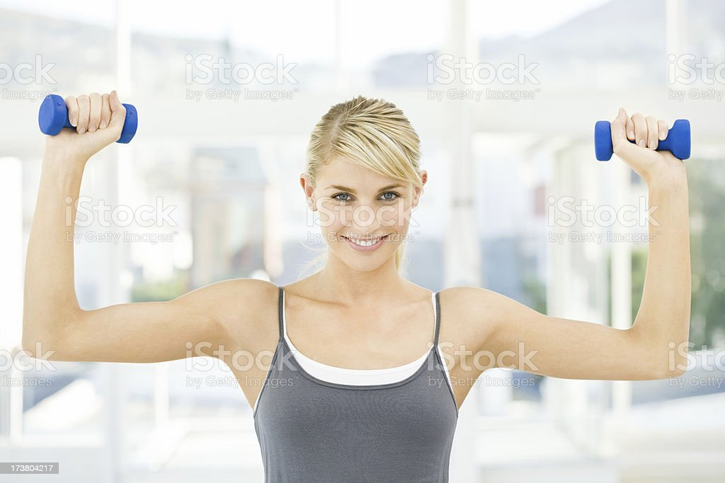 Young woman holding dumbbells royalty-free stock photo