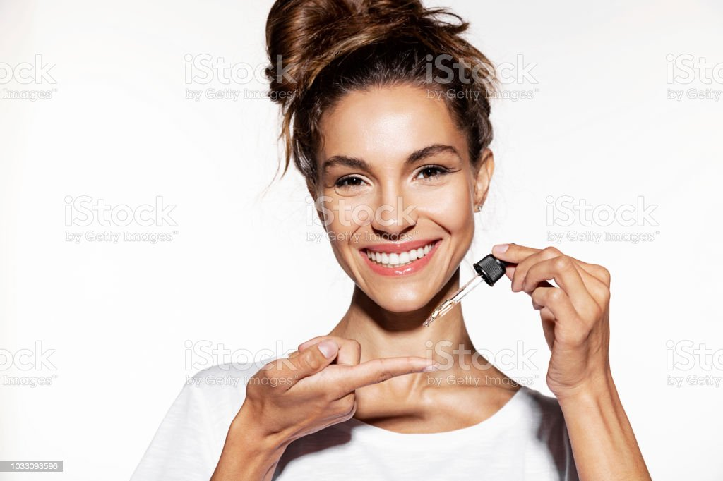 Young woman holding  face oil. royalty-free stock photo