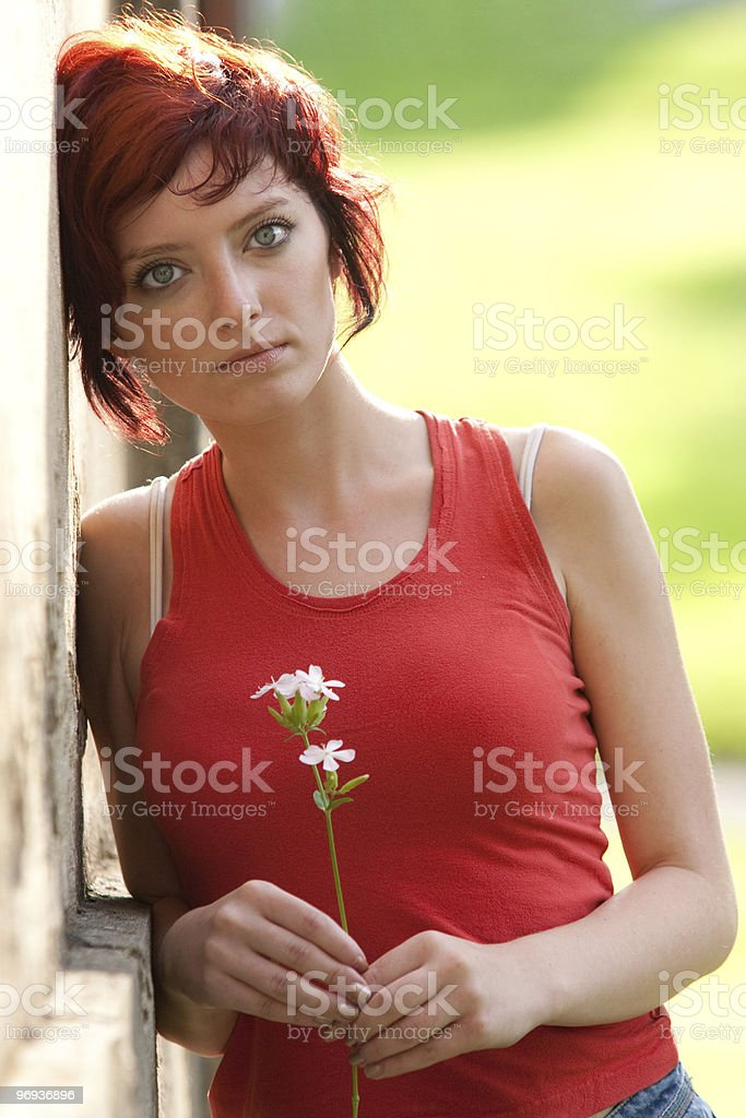 Young Woman Holding Flower royalty-free stock photo