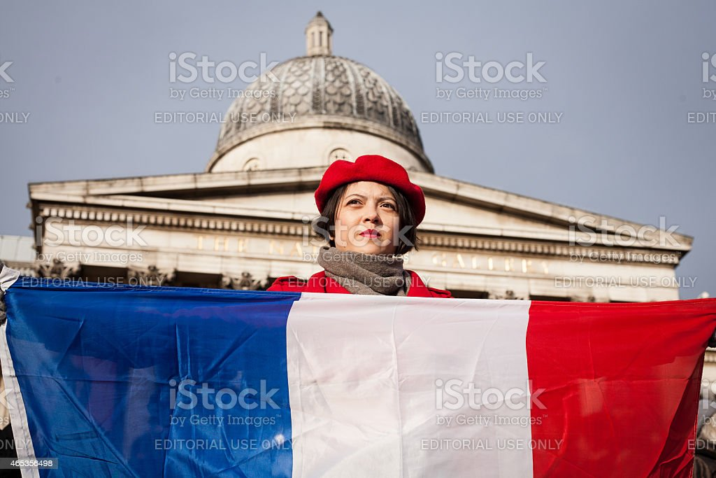 Young woman holding French flag stock photo