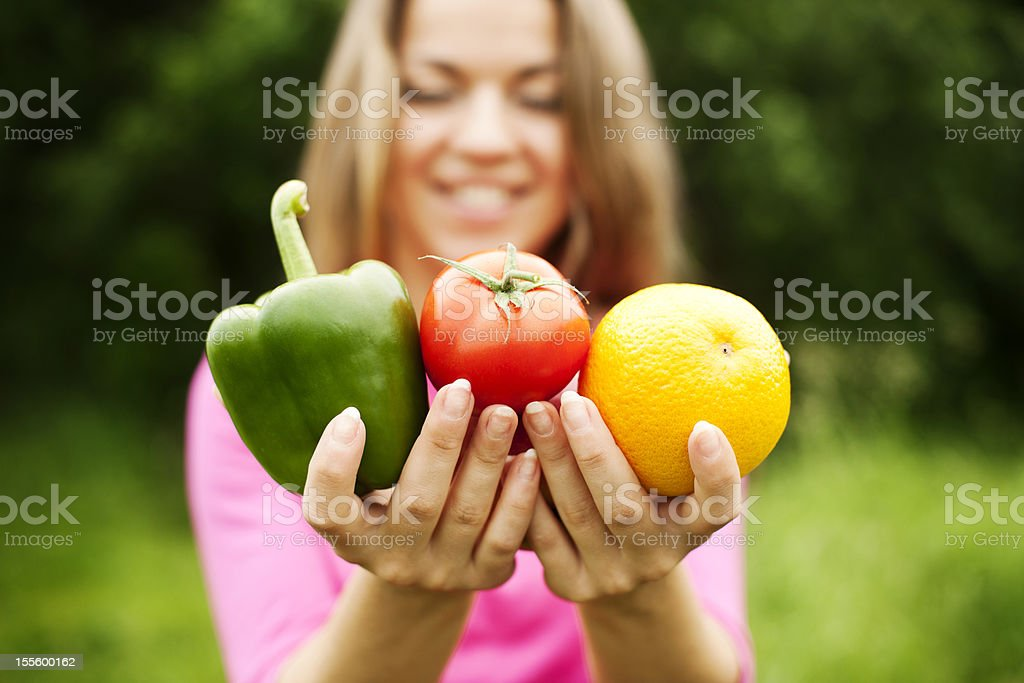 Young woman holding fruits and vegetables royalty-free stock photo