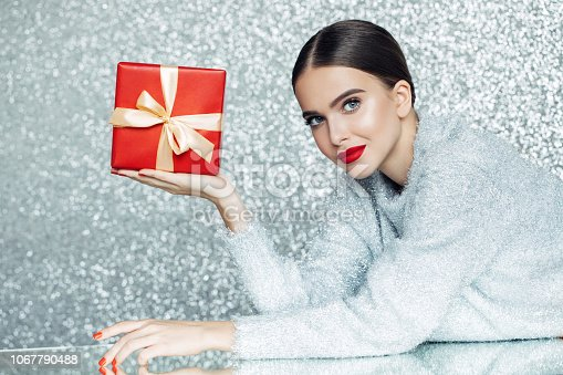 Young woman holding gift box in her hands