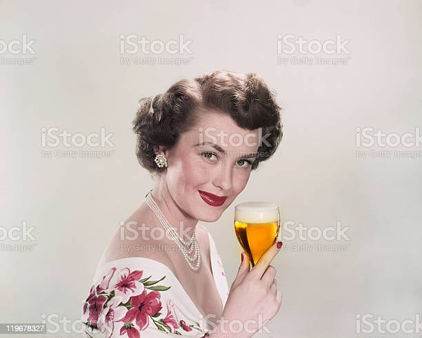 Young woman holding glass of beer smiling portrait picture id119678327?b=1&k=6&m=119678327&s=612x612&h=bgffmd5ac6 gqyt7y up4ipkuq qm4vy1hu1weneo3s=