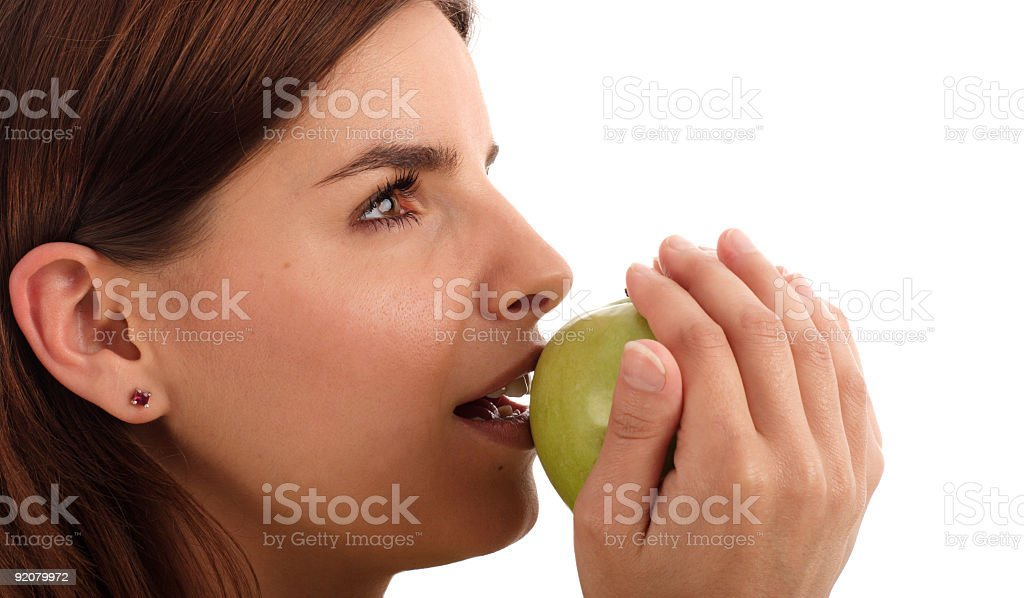 Young woman holding green apple stock photo