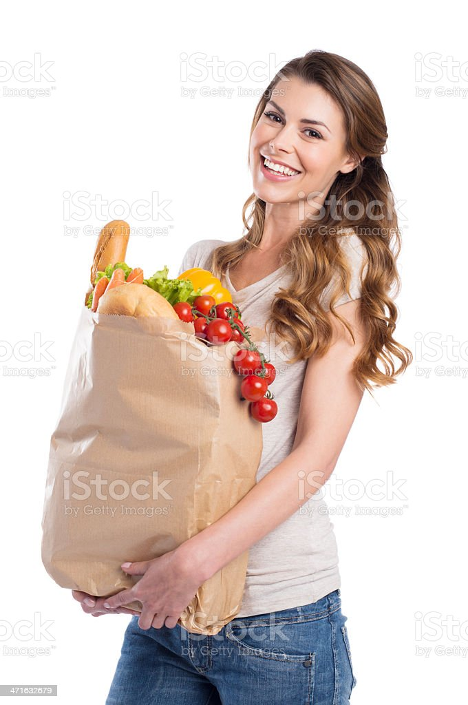 Young Woman Holding Grocery Bag stock photo