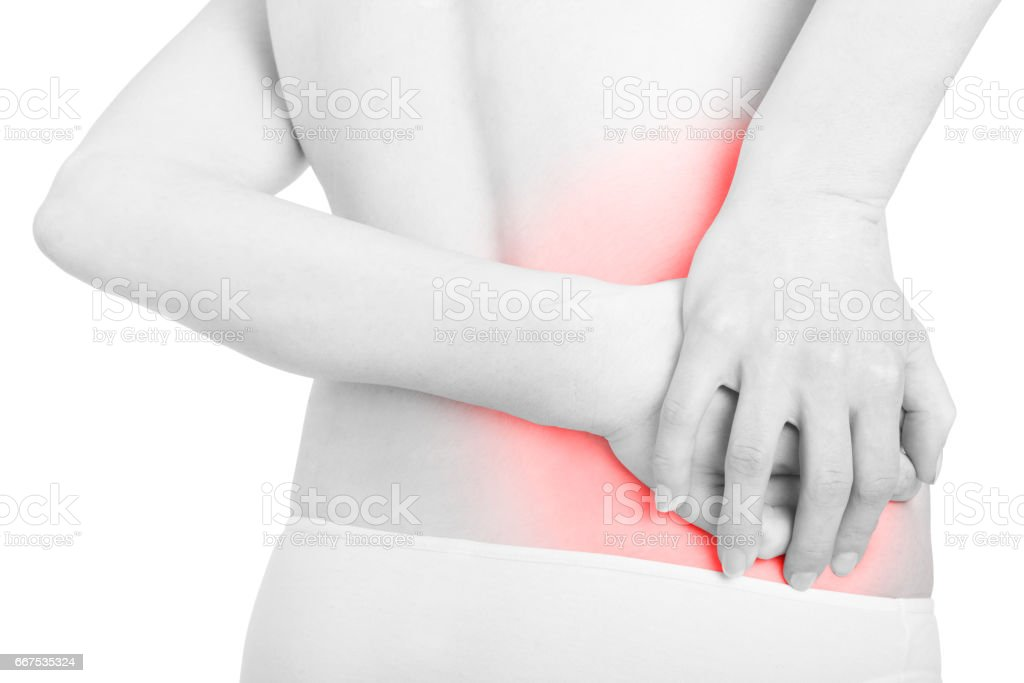 Young woman holding hands on red painful area, backache on white, clipping path foto stock royalty-free