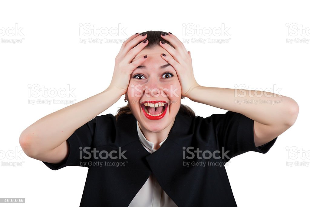 Young woman holding head and screaming happily stock photo