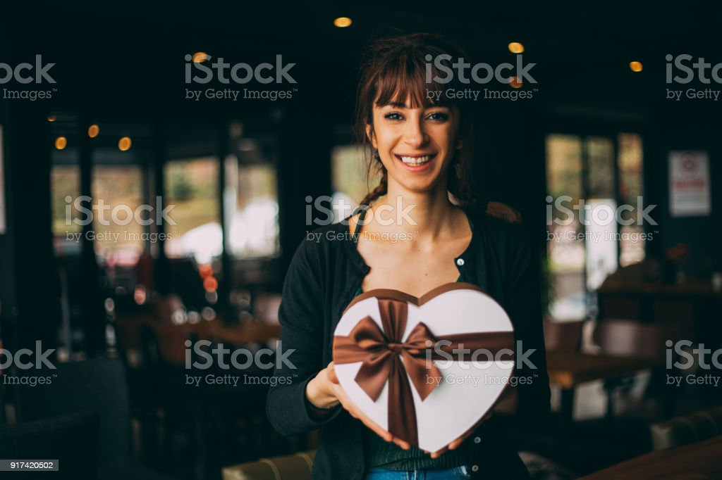Young Woman Holding Heart Shaped Gift Box On Valentines Day