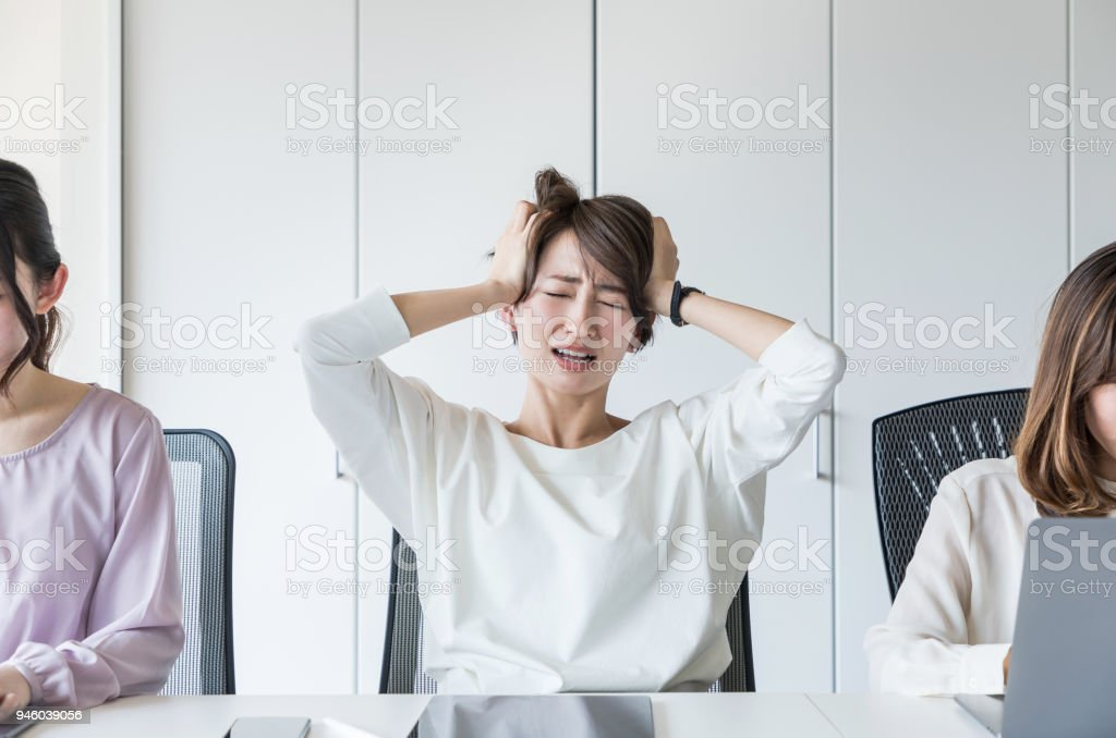 Young woman holding her head. stock photo