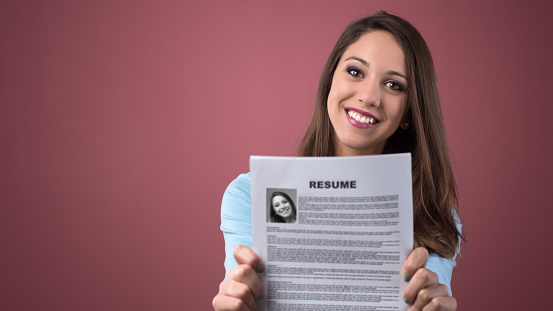 Young Woman Holding Her Resume Stock Photo - Download Image Now
