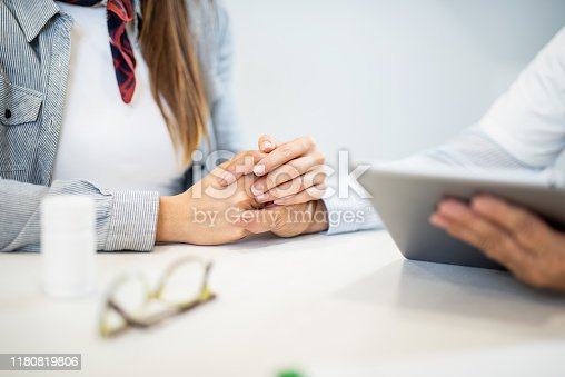 667827758 istock photo Young woman holding her supportive doctor's hand close up. 1180819806