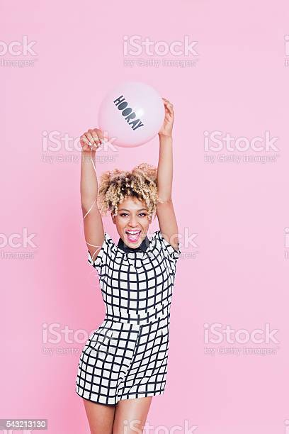 Young Woman Holding Hooray Balloon Stock Photo - Download Image Now