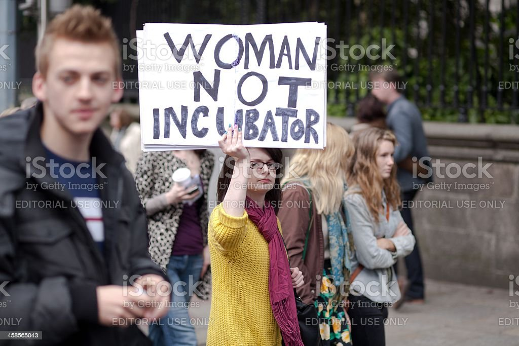 Young woman holding informational poster stock photo