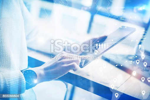istock Young woman holding modern digital tablet on hands.Concept business people using mobile devices.Icon and graphs on the background display.Visual effect, blurred.Horizontal. 855066804
