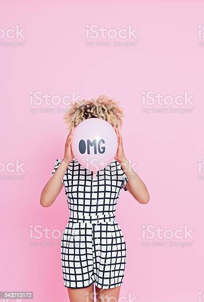 Young Woman Holding Omg Balloon Stock Photo - Download Image Now