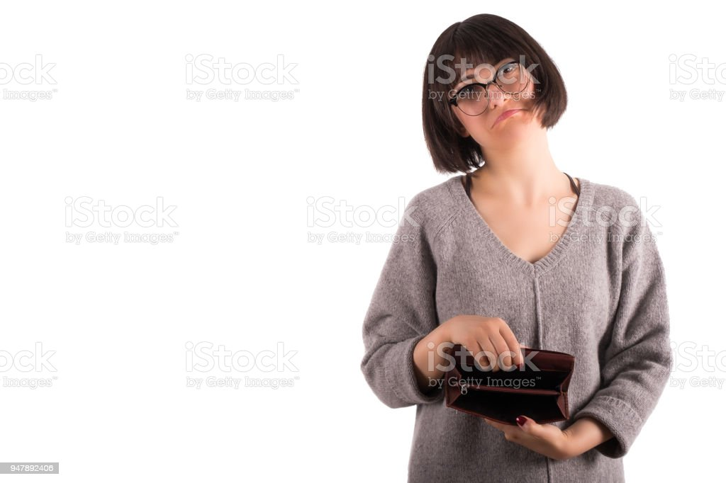 Young Woman Holding out Her Empty Purse Desperately stock photo