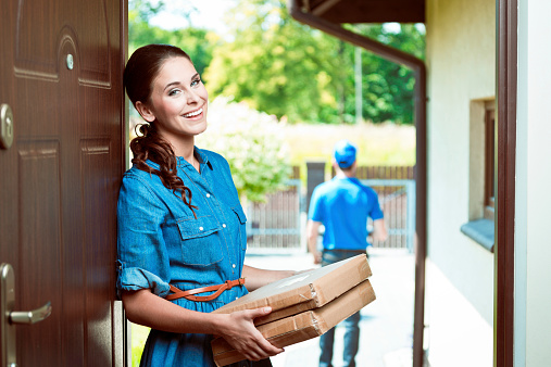 Young Woman Holding Packages Stock Photo - Download Image Now