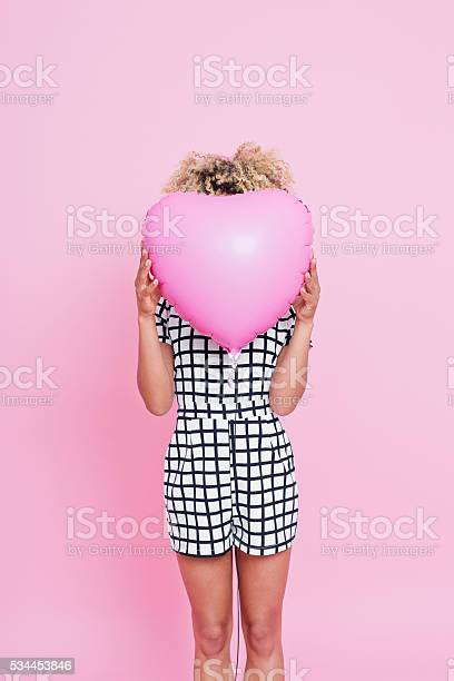 Young Woman Holding Pink Heart Shaped Balloon Stock Photo - Download Image Now