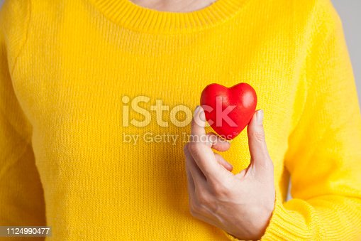 Female hand holding red heart, Love concept for valentines day with sweet and romantic moment