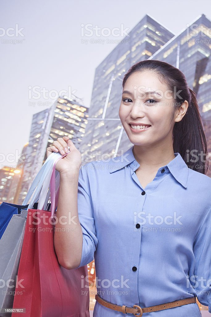Young Woman Holding Shopping Bags royalty-free stock photo