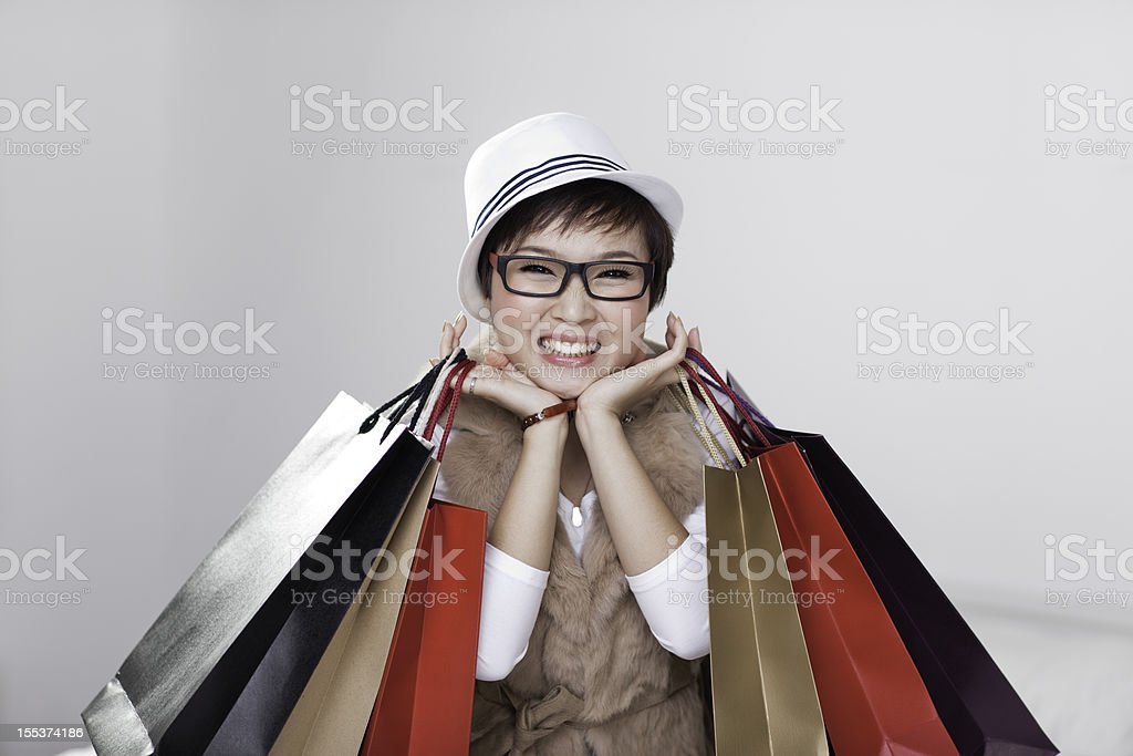Young woman holding shopping bags, smiling royalty-free stock photo