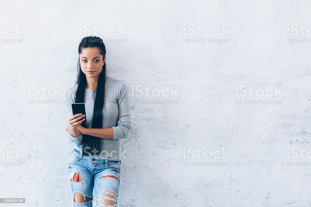 Young woman holding smart phone stock photo