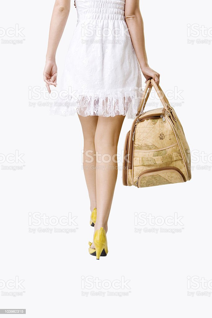 Young woman holding suitcase royalty-free stock photo