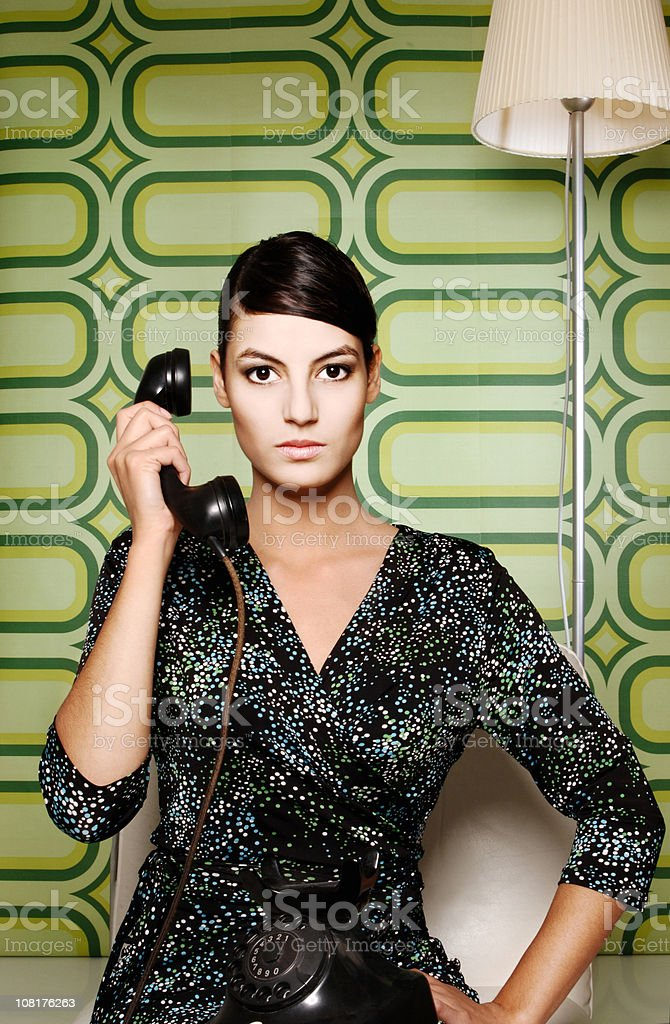 Young Woman Holding Telephone royalty-free stock photo