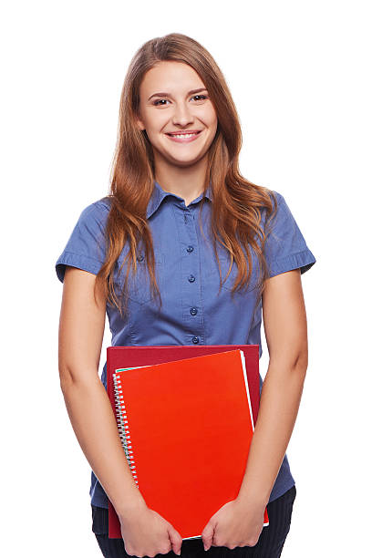 Young woman holding textbooks stock photo