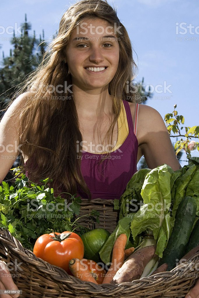 Young woman holding the fruits of her labor royalty-free stock photo