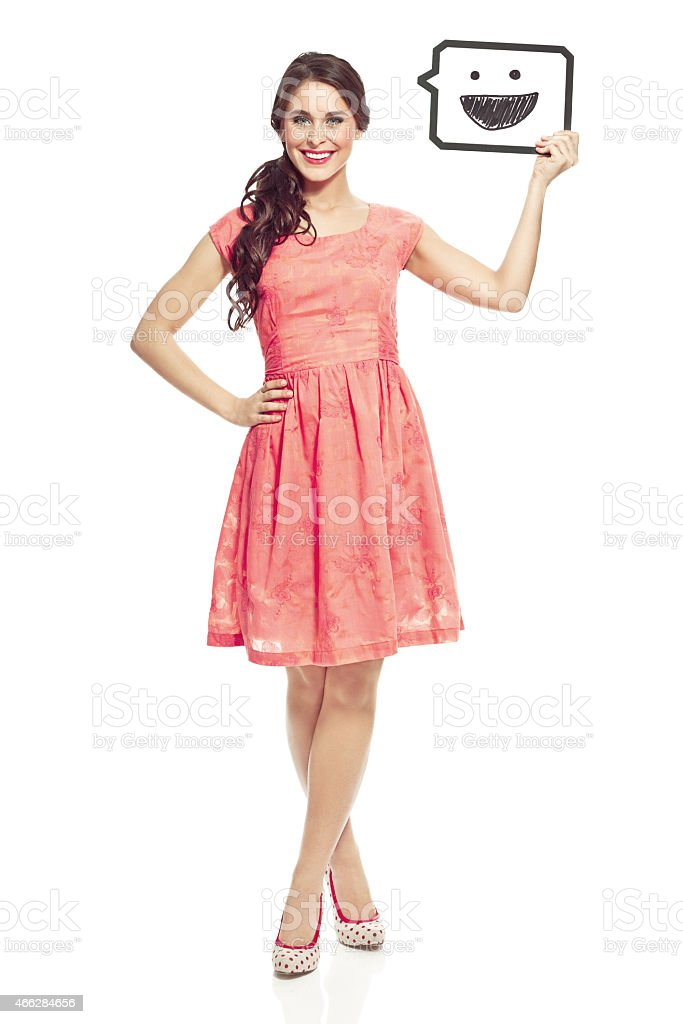 Young woman holding thought bubble Concept portrait of happy young woman holding thought bubble with smiling face. Studio shot, isolated on white. 20-24 Years Stock Photo