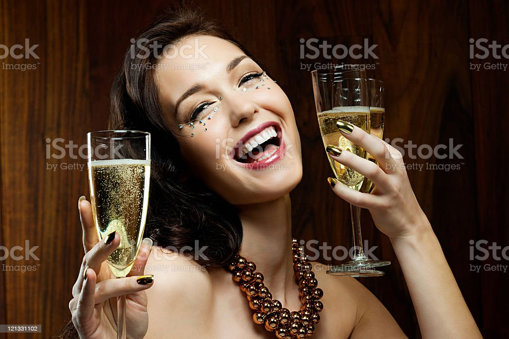 Young woman holding three champagne flutes stock photo