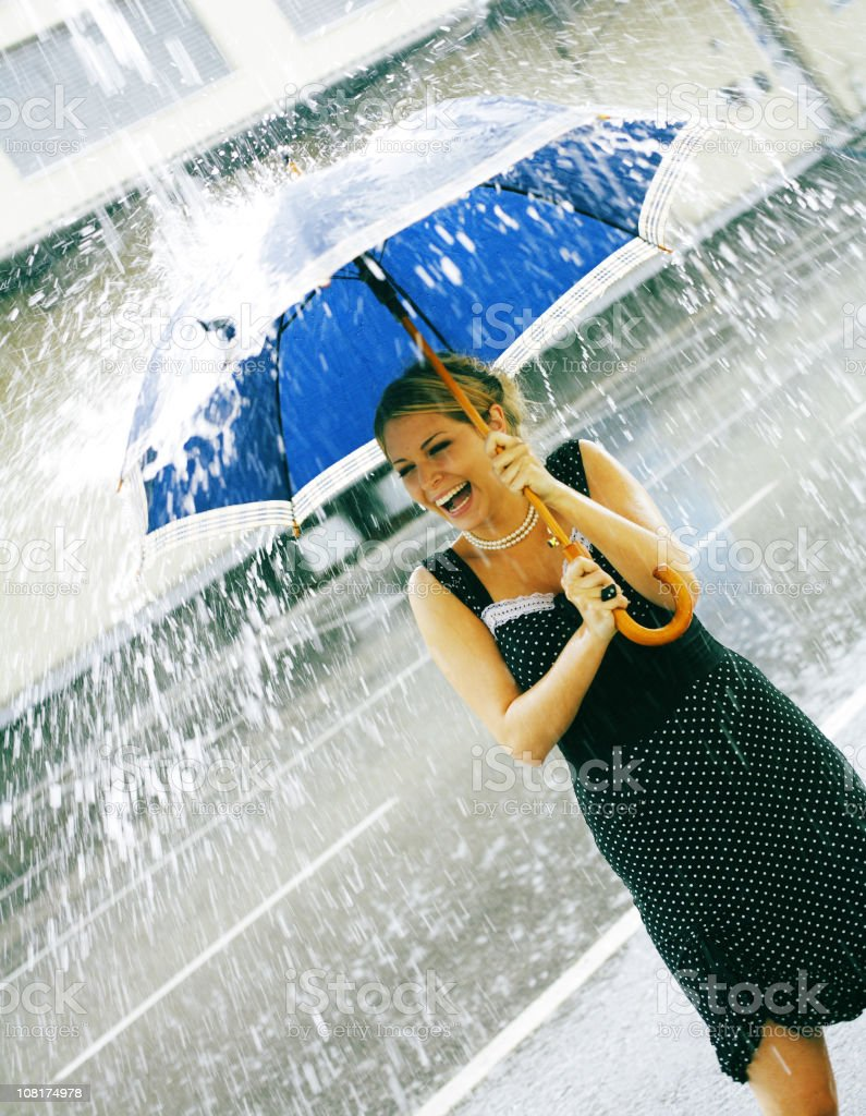 Young Woman Holding Umbrella During Rain Fall royalty-free stock photo
