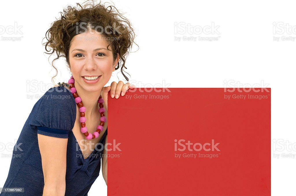 Young woman holding up a board royalty-free stock photo