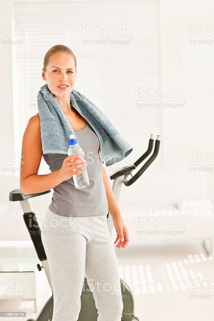 Young woman holding water bottle royalty-free stock photo