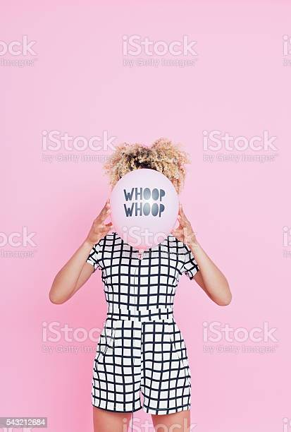 Young Woman Holding Whoop Whoop Balloon Stock Photo - Download Image Now