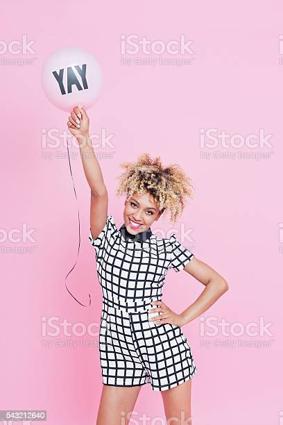 Young Woman Holding Yay Balloon Stock Photo - Download Image Now
