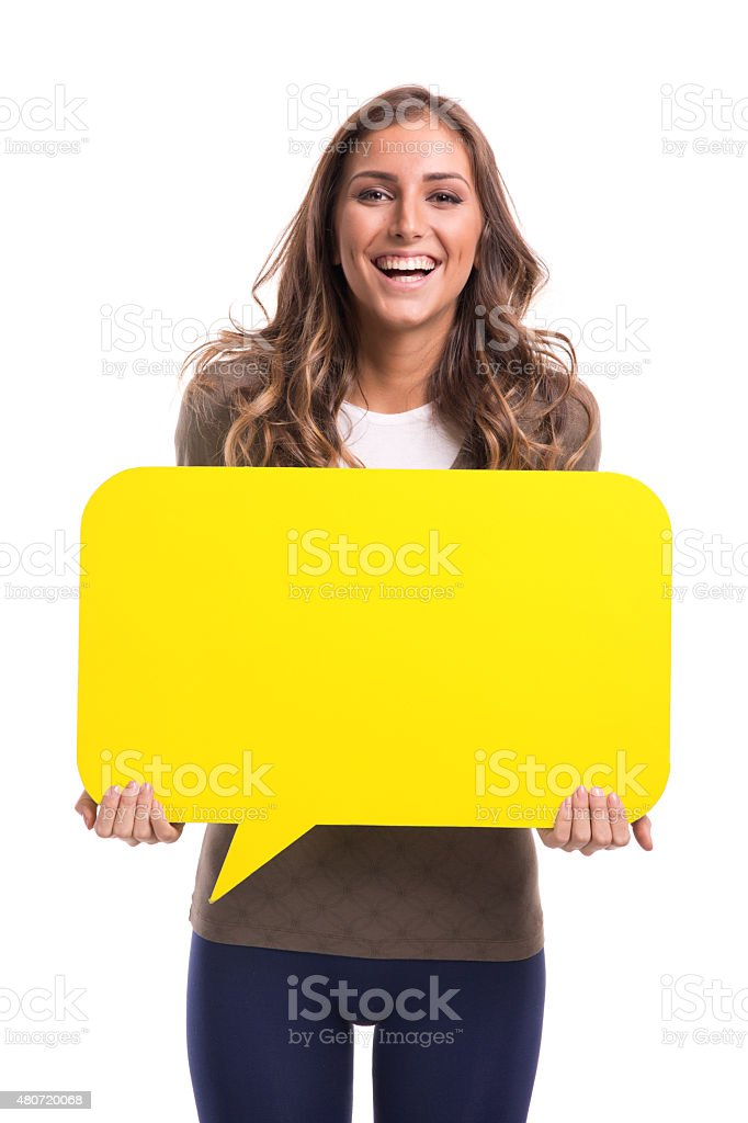 Young woman holding yellow speech bubble stock photo