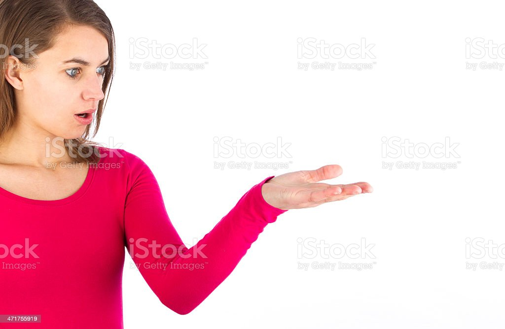 young woman holding your amazing product in hand stock photo