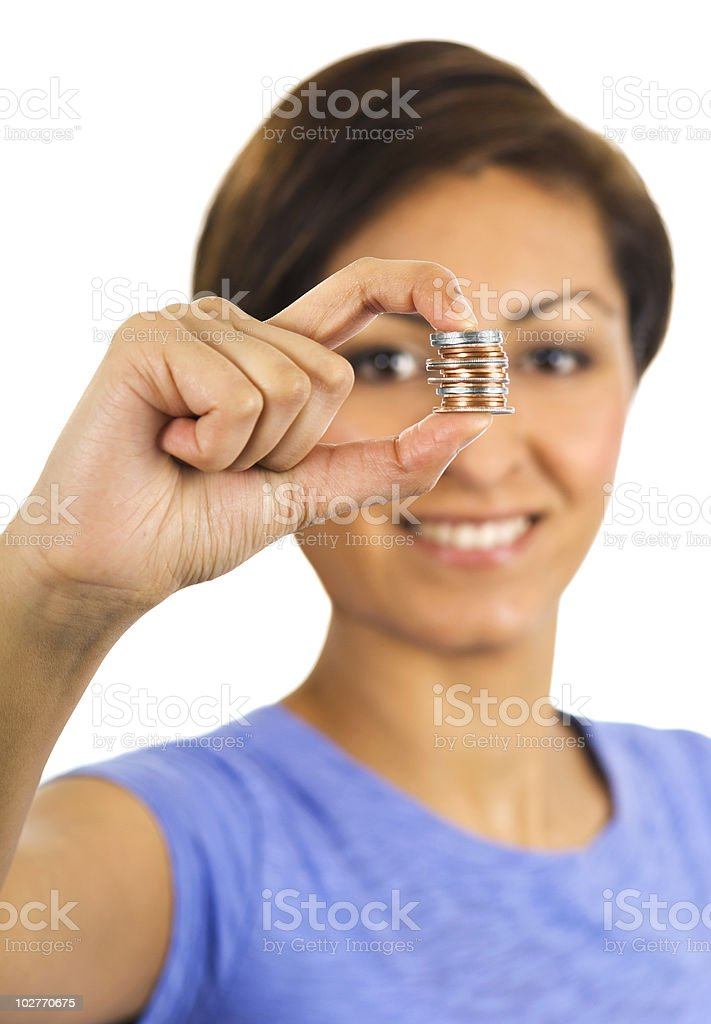 Young woman holds a stack of coins between her fingers. royalty-free stock photo